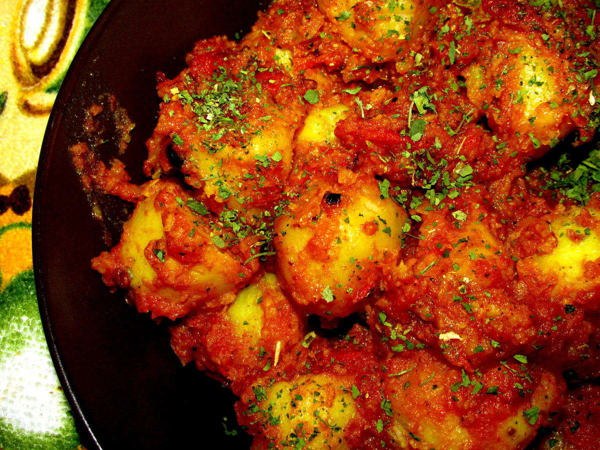 Dum Aloo belongs to, specifically, Kashmiri cuisine . The potatoes ...